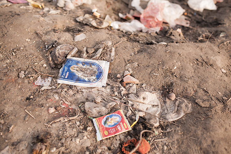 The empty packets of incense and colors in the bank of Yamuna River